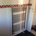 Heated towel rail installation